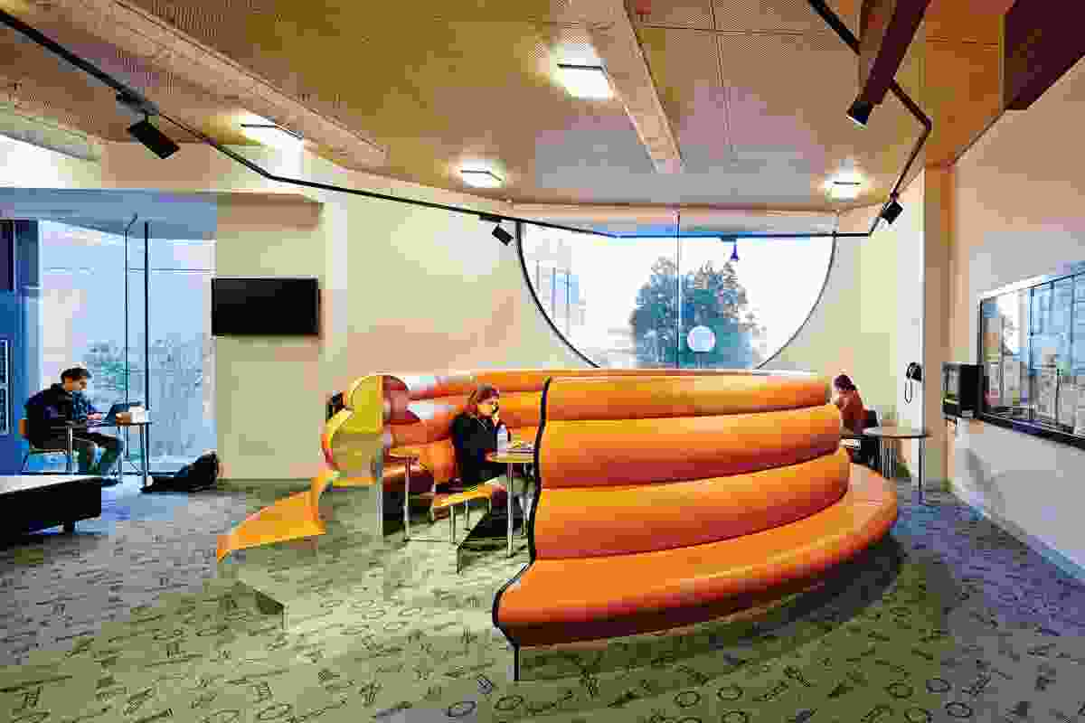 A circular lounge in the student commons room coils like a snake.