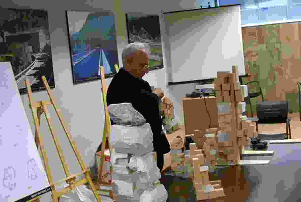 A scene from The Compeitition where Frank Gehry surveys a range of models before his jury presentation.