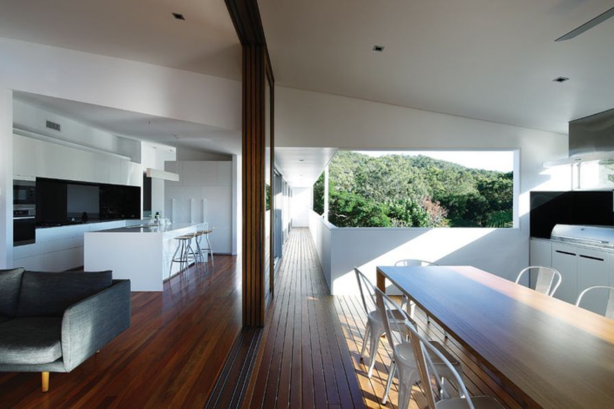 Timber sliders divide the living and outdoor rooms.