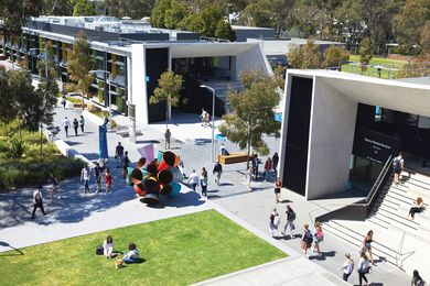 Students stroll through the North West Precinct at Monash University's Clayton campus, designed by Outlines Landscape Architecture