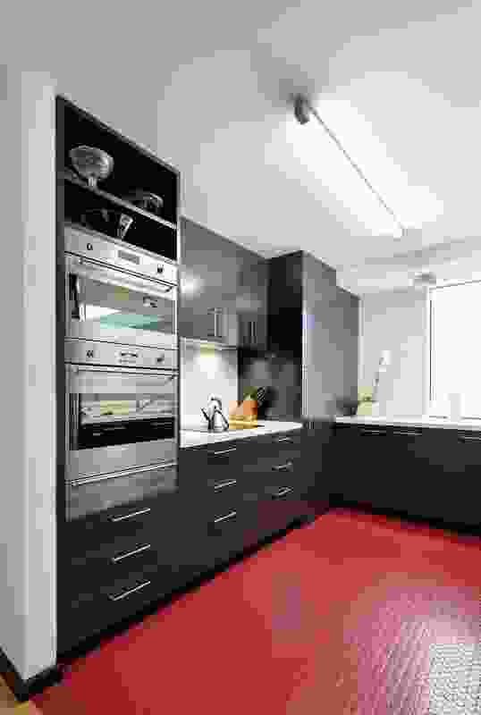 The new kitchen features a boldly coloured, studded rubber floor.