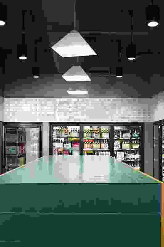 The liquor store uses olive-green tiles to differentiate itself from the grocery.