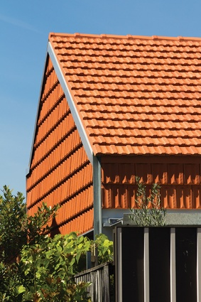 Terracotta tiling – a familiar palette used in an unusual way.