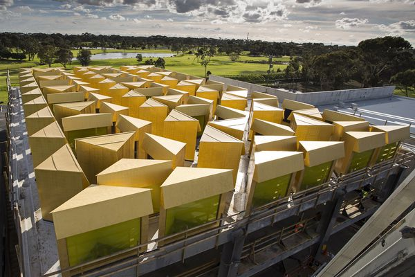 The Australian Islamic Centre by Glenn Murcutt and Elevli Plus Architects features 96 gold painted lanterns which funnel coloured light into the space below.