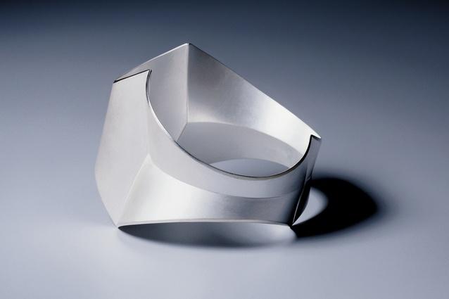 The silver Shot 4 bracelet (1998).