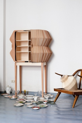 Elisa Strozyk's Accordion Cabinet, made from flexible wood textiles, won first prize.