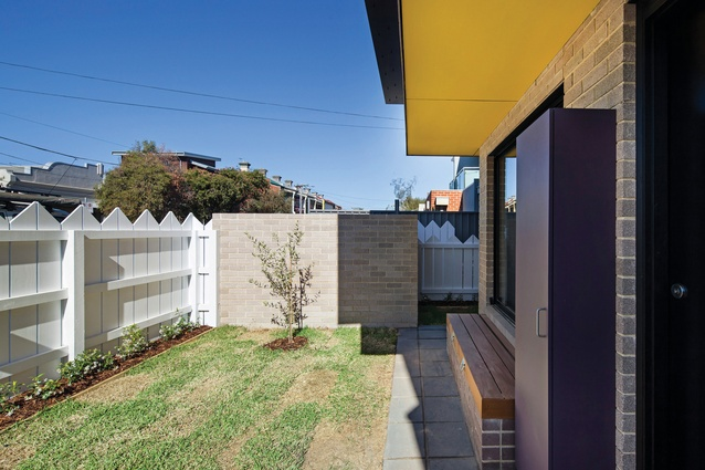 """The picket fence, a ubiquitous suburban signifier, celebrates """"home"""" with its exaggerated form."""