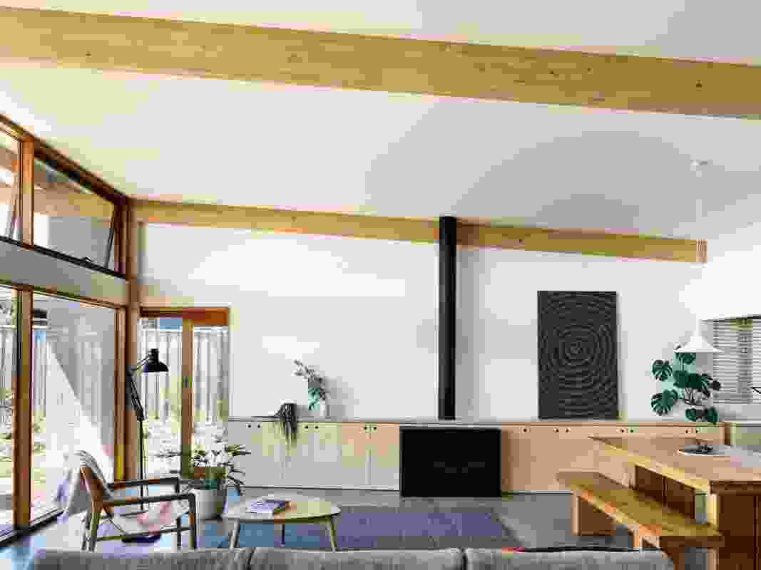 The expression of the exposed beams speak to the architects' interest in celebrating structure rather than hiding it. Artwork: Lily Kelly Napangardi.