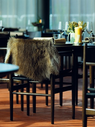 The dining room features Danish chairs with wallaby fur throws.