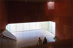 Interior of the Red Box, with its contemplative framing of the river surface. The space also provides an internal link between the two levels of the State Reference Library. Image: Jon Linkins