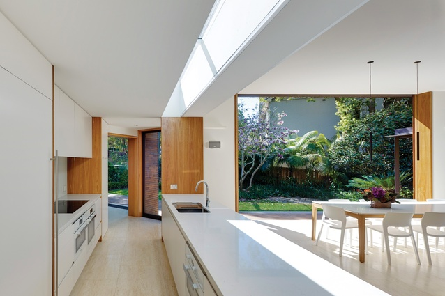 A series of skylights delivers light deep into the pavilions, as seen here above the kitchen bench in the second pavilion.