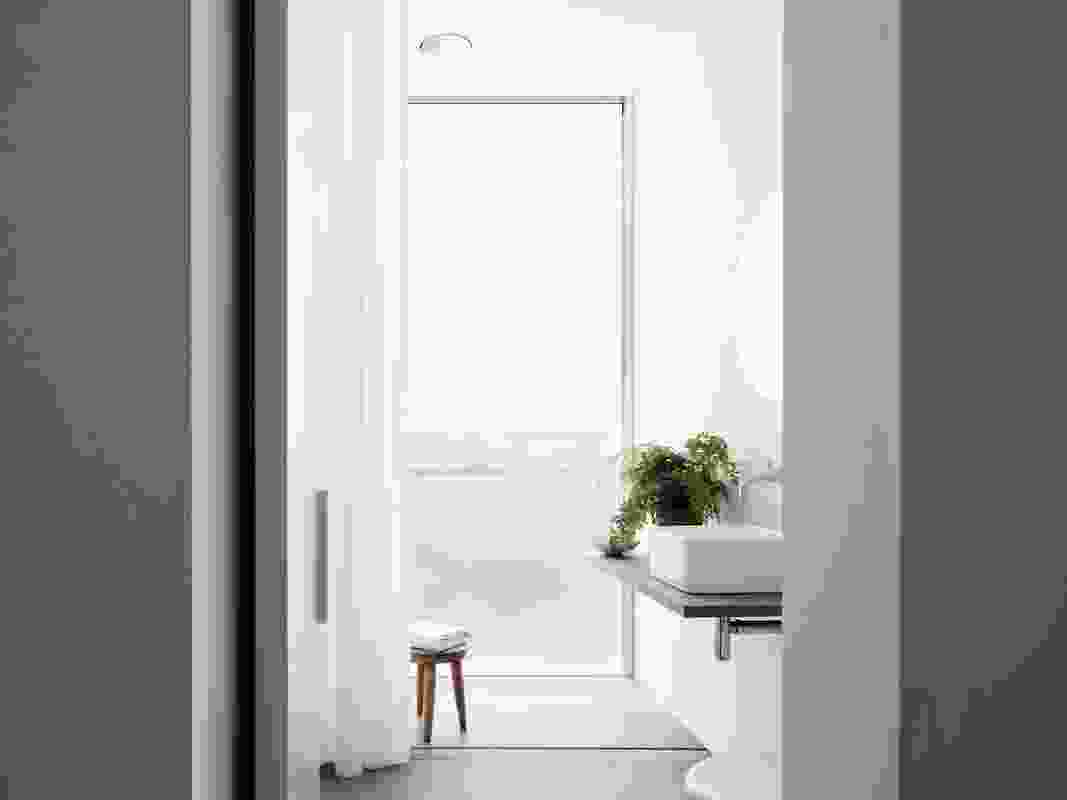 The poetry and feeling of calm throughout the home is continued into the bathrooms and other service spaces.