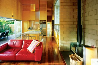 An oblong glazed wall floods the space with diffuse light.