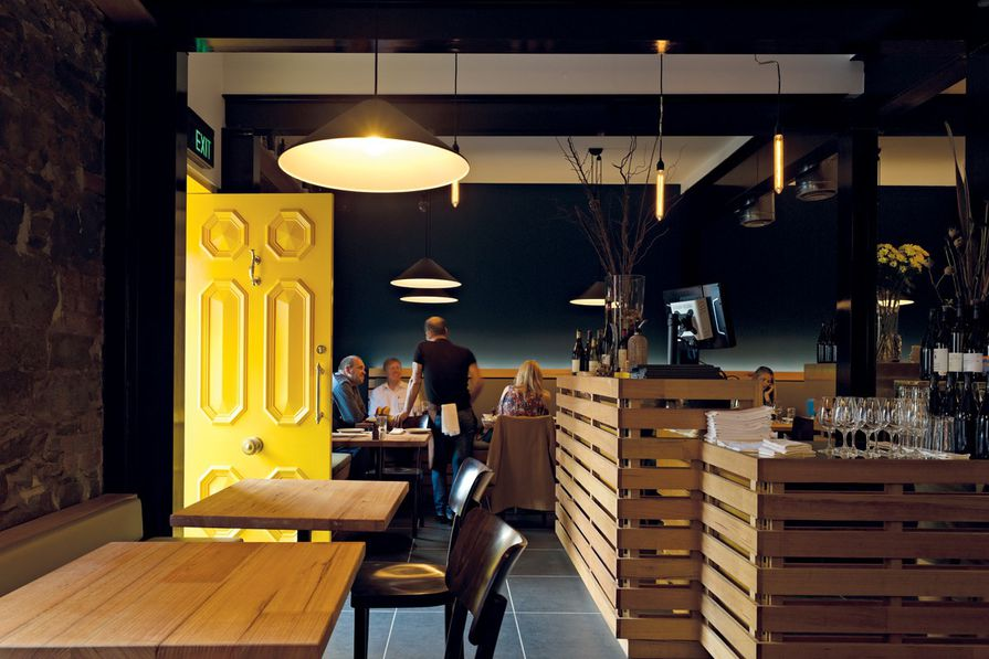 Timber and brass dominate the main restaurant and bar.