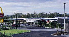 Overview of the Coomera BP, the linear version of Arkhefield's new model, showing the canopy folding down to create an intimate scale at the building entrance.