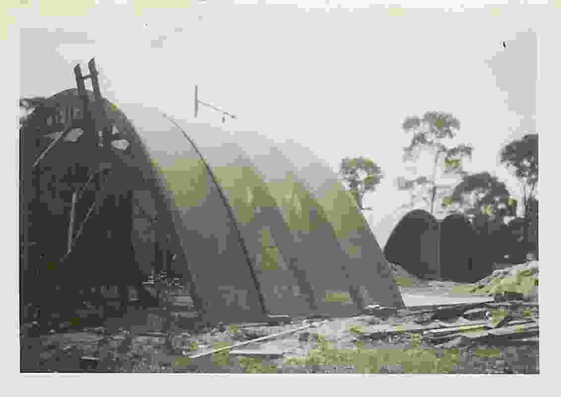 Rice House by Kevin Borland under construction, showing hessian-covered timber arches.