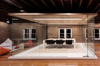 The floating fitout barely touches the heritage-listed building shell.