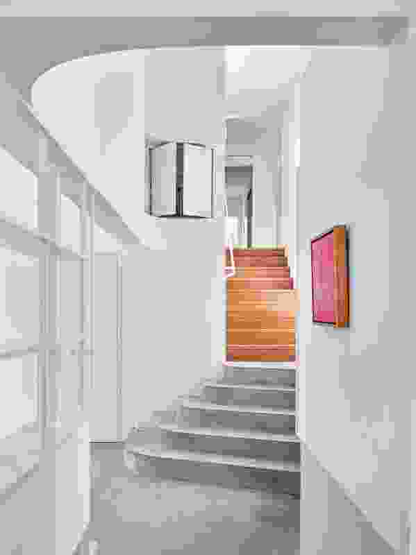 A staircase has been introduced to manage the gentle clamber from old to new, with timber transitioning to concrete. Artwork: Kathleen Ngale.