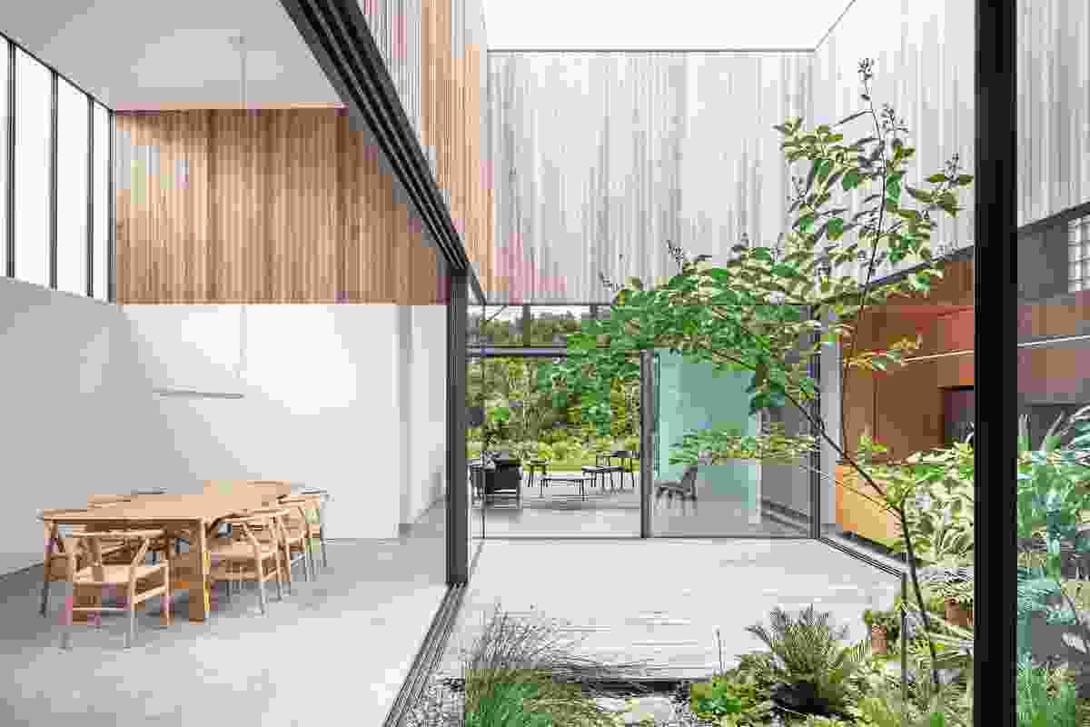 "Kitchen, living and dining rooms adjoin the courtyard, allowing seamless movement between these ""public"" spaces."