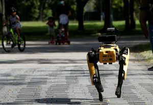 A robot dog called Spot patrols a Singapore park playing a recorded message telling people to observe physical distancing measures.