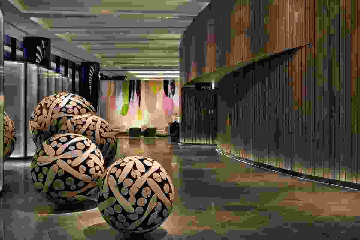 Chestnut sculptures by Lee Jae-Hyo in the foyer of Melbourne's Crown Metropol.