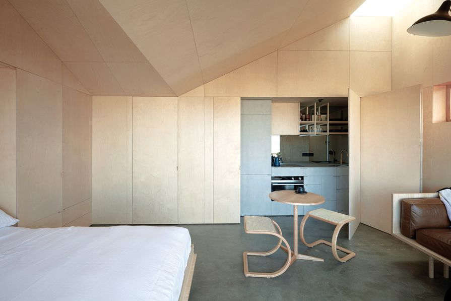 The plywood skin offers continuity across walls, joinery and the unique vaulted ceiling.