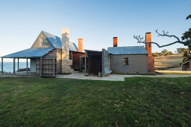 One of four chimneys, acting like markers in the landscape, warms the entry court with its fireplace. Its thin, near-white bricks were baked in Stawell, Victoria.