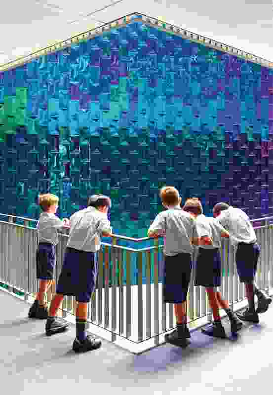 The iridescently tiled hub containing the library and information technology spaces references the work of British architect James Stirling.