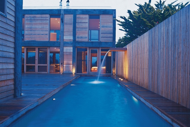 The Merimbula House includes a large swimming pool that runs along the side of the central decked courtyard.