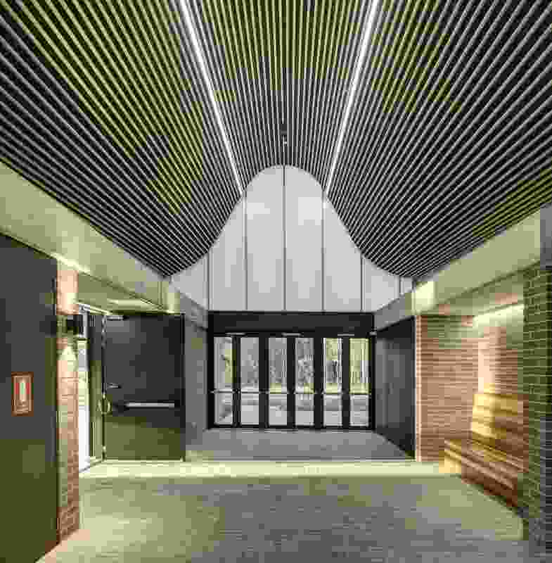 The undulating roof of Woodcroft Neighbourhood Centre by Carter Williamson Architects arches over the central foyer.