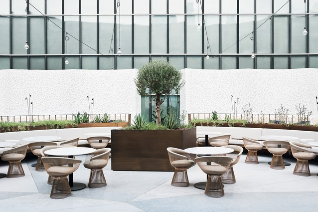 The ideal place for a long lunch, the courtyard features suspended festoon lighting and bronzed planters.