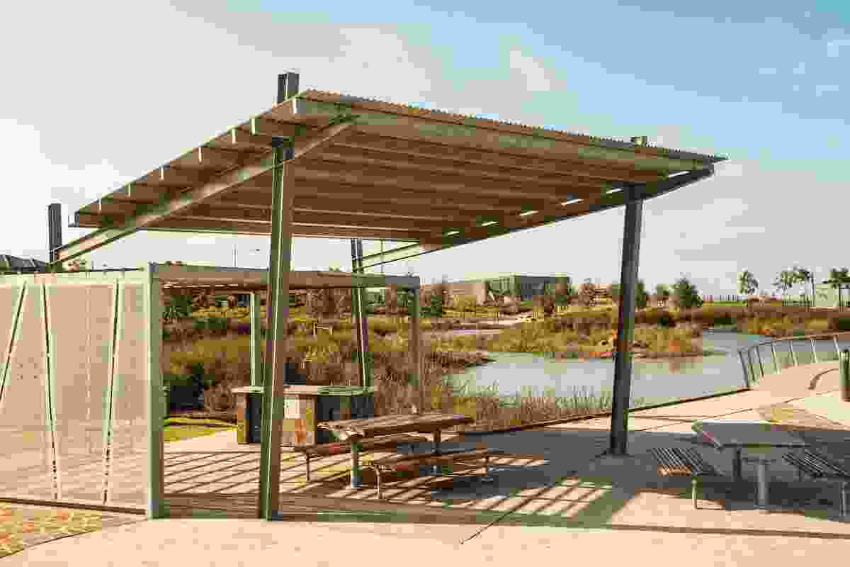 Picnic and barbecue areas are located next to water and scrub land.