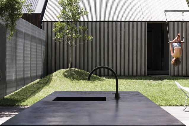 A separate garage/ studio bookends the site and the main garden sits between it and the home.