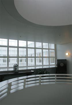 The main central void, looking from level 1 out into the glazed internal courtyards. Photograph Ben McMillan.