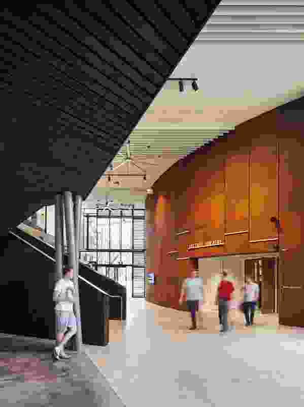 Two corten-clad ellipsoidal drums contain the main lecture theatre and a series of seminar rooms.