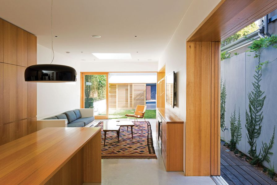 The living areas feature glazed bands of  timber-framed sliding doors.