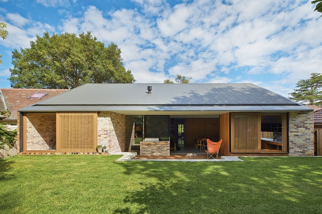 The house's modestly scaled, low-slung form allows it to fit comfortably into its suburban setting.