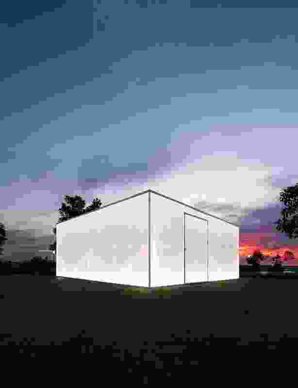 The solid appearance of Blak Box transforms at night, when the exterior polycarbonate panels take on a translucent, watery effect.