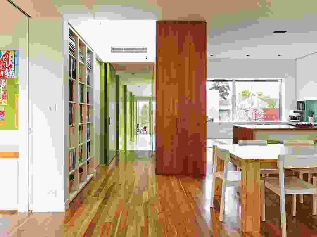 Floor-to-ceiling pivot doors painted lime.