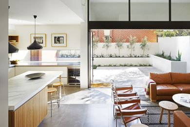 Light pours into the kitchen from the larger of two courtyards on the ground floor. Artwork: Max Dupain.