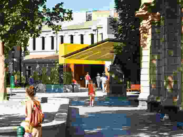 The building's presence on Lyttleton Terrace is announced by the brightly coloured canopy of the new addition.