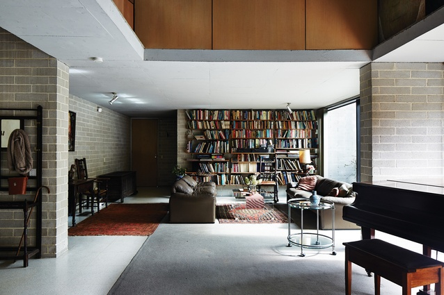 "A wall of books is the living room's giant ""abstract painting."""