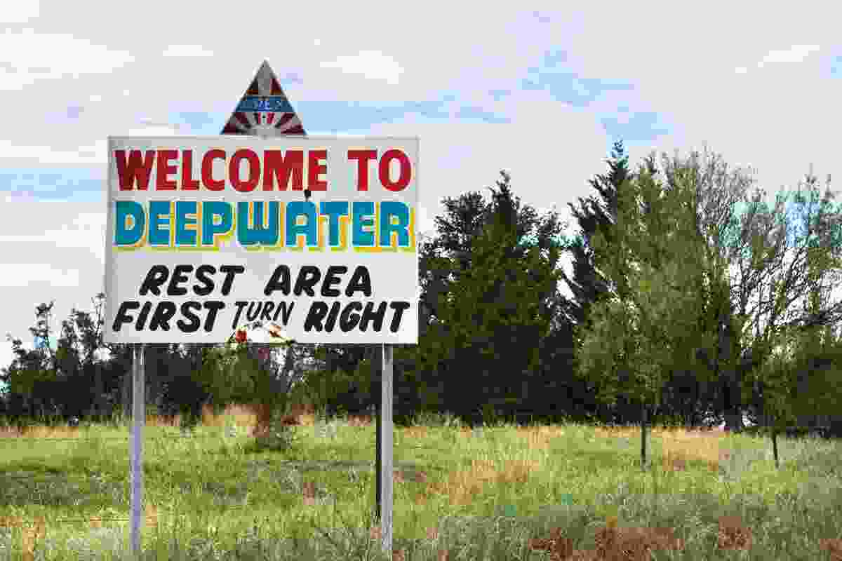 This photograph at Deepwater in the Northern Tablelands shows a sign that lures tired motorists with the promise of a rest area ahead.