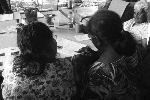 Cissy Djiagween and Jane Augustine reviewing the report.