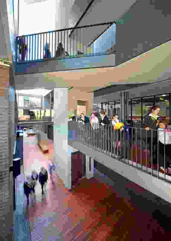 A central plaza is connected by split-level stairs to other parts of the school.