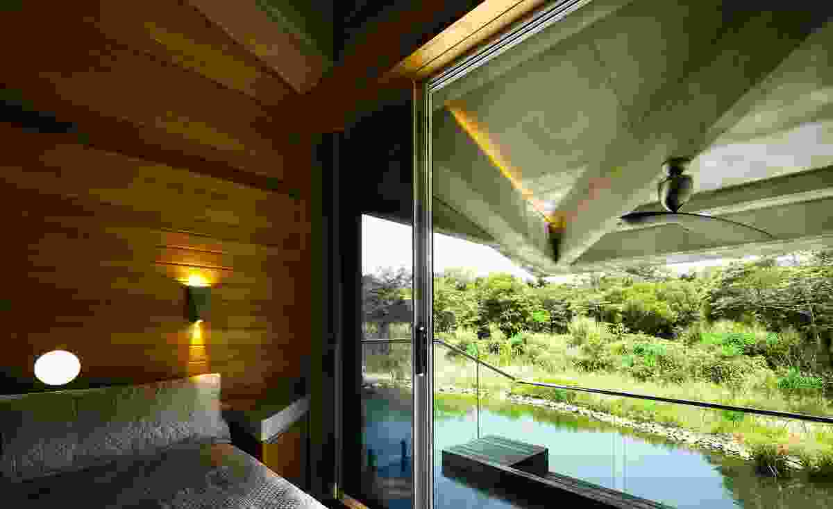 The bedrooms in self-contained pods cantilever over the water.