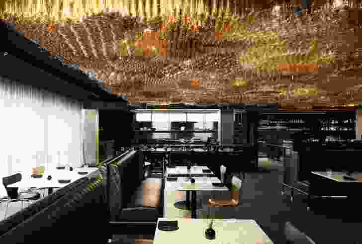 """The restaurant, playfully named Doot Doot Doot, features a """"bubbling golden ceiling"""" made from 10,000 Edison globes."""