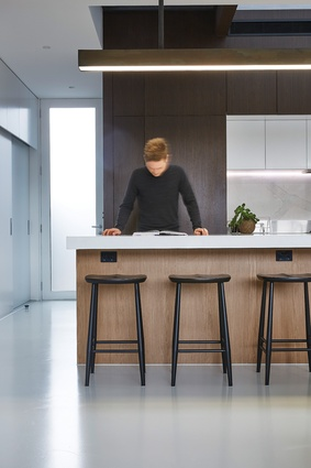 Joinery sits short of the ceiling, allowing the light and spaciousness of the void to expand into the living and kitchen zone.