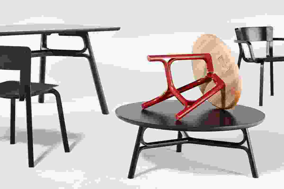 Justin Hutchinson Flow tables in natural rubberwood, red and black.