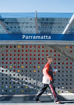 Movement Through Landscape, a public artwork by McGregor Westlake Architecture, mediates between the elevated station and the surrounding streets. The coloured baked enamel cups symbolize the movement of people through the station.
